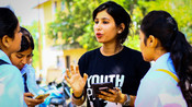 Rajshree, one of our Youth Accountability Advocates talking with young people about gender equality and family planning in Jharkhand, India.