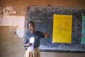 Ritah, ICS volunteer running a sanitary pad making workshop