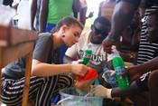 Volunteers leading soap making workshops as part of International Citizenship activities in Jinja, Uganda.