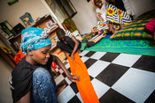 Neema, a peer educator running batik cloth making lessons with out of school girls as part of our Girls Lets be Leaders! project in Tanzania.