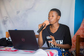 Devota, one of our Youth Accountability Advocates, sharing her findings on gender equality and family planning indicators at our Dissemination of Research Findings Dialogue in 2018 in Iringa, Tanzania