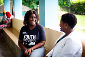 Aisha, a Youth Accountability Advocate, speaking with a health worker about family planning service provision as part of our Keep Your Promise project in Tanzania.