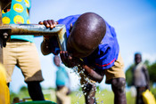 A young boy enjoying clean water from the water system that Franco convinced the authorities to implement in the community to help with agriculture.