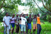 Franco (pictured in the centre in the white restless t-shirt) with karamajong people on climate smart agriculture as part of our Youth Motivations project.