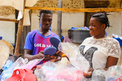 Mary, (right) pictured operating her mobile business.  Mary is one of the 8,636 girls reach by our Business Brains project which aims to develop the entrepreneurship skills and self care practic